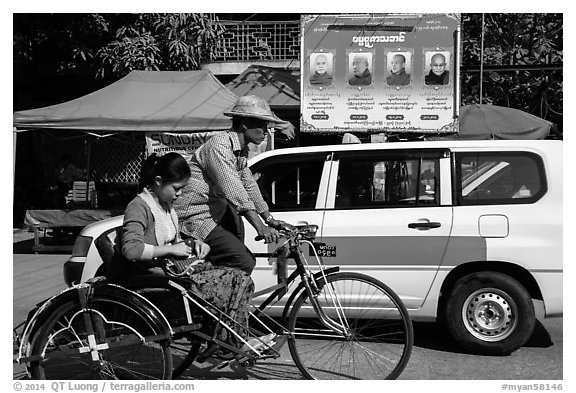 Trishaw, taxi, and billboard promoting monks. Yangon, Myanmar (black and white)