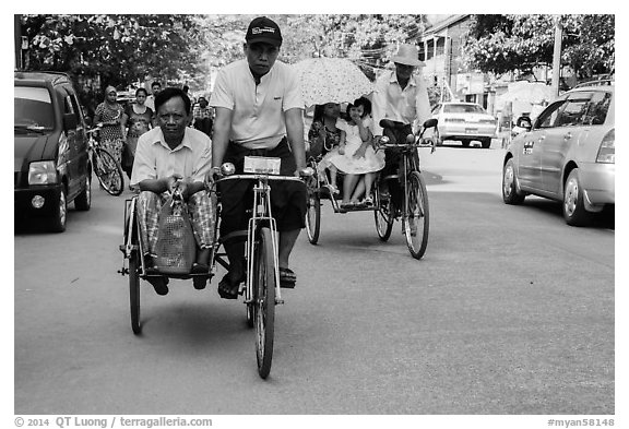 Trishaws on street. Yangon, Myanmar (black and white)