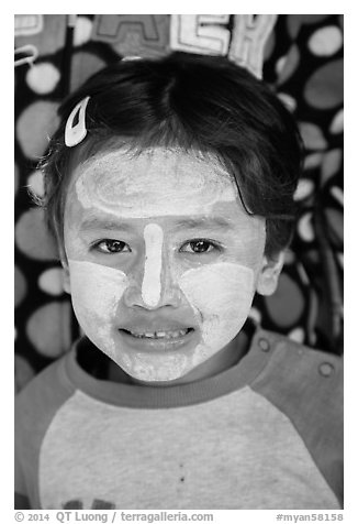Infant with face covered in thanaka paste. Bagan, Myanmar (black and white)