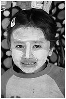 Infant with face covered in thanaka paste. Bagan, Myanmar ( black and white)