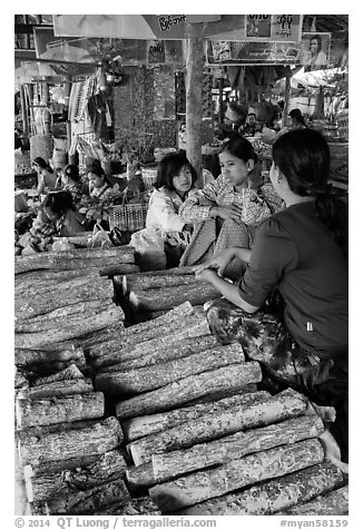 Women selling wood ground to make thanaka. Bagan, Myanmar (black and white)