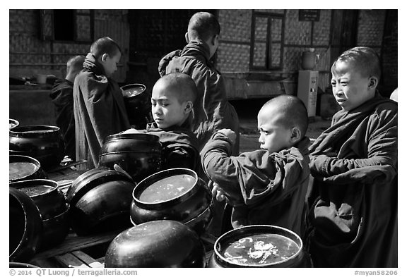 Novices getting ready for lunch, Nyaung U. Bagan, Myanmar (black and white)