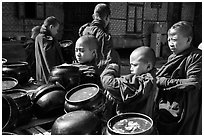 Novices getting ready for lunch, Nyaung U. Bagan, Myanmar ( black and white)