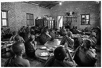 Novices in prayer before lunch, Nyaung U. Bagan, Myanmar ( black and white)