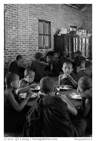 Young Buddhist monks in dining room. Bagan, Myanmar (black and white)