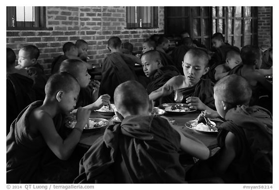 Novices eat lunch, last meal of the day. Bagan, Myanmar (black and white)