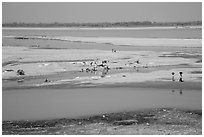 Sandy banks of Ayeyarwaddy River with villagers washing clothes. Bagan, Myanmar ( black and white)