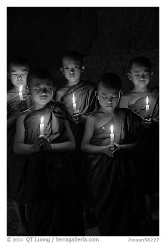 Group of buddhist novices holding candles. Bagan, Myanmar (black and white)