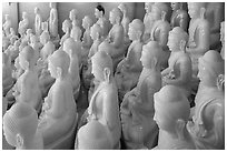 White marble buddha statues for sale. Mandalay, Myanmar ( black and white)