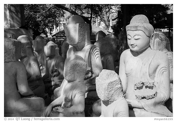 Buddha statues in various stages of completion on Marble street. Mandalay, Myanmar (black and white)