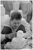 Sculptor with face covered in fine marble dust. Mandalay, Myanmar ( black and white)