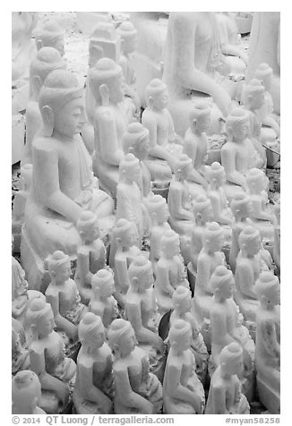 Unfinished white marble buddha statues of various sizes. Mandalay, Myanmar (black and white)