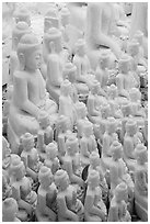 Unfinished white marble buddha statues of various sizes. Mandalay, Myanmar ( black and white)