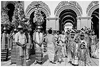Young children and families gathering for noviciation ceremony, Mahamuni Pagoda. Mandalay, Myanmar ( black and white)