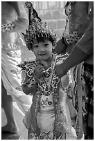 Young girl dressed in glittering attire during novitiation, Mahamuni Pagoda. Mandalay, Myanmar ( black and white)