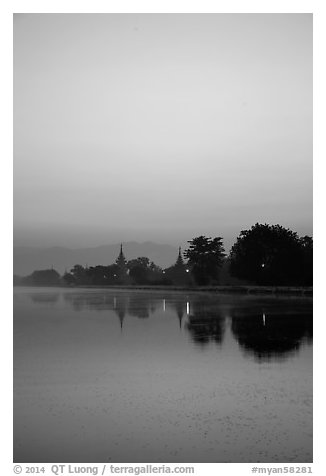 Pastel colors of dawn on Mandalay Fort moat. Mandalay, Myanmar (black and white)