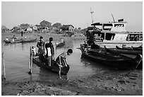 Passengers disembark from boat after short crossing. Mandalay, Myanmar ( black and white)