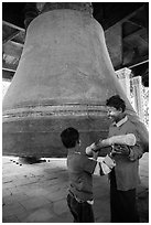 Children ring the huge Mingun bell, Mingun. Myanmar ( black and white)