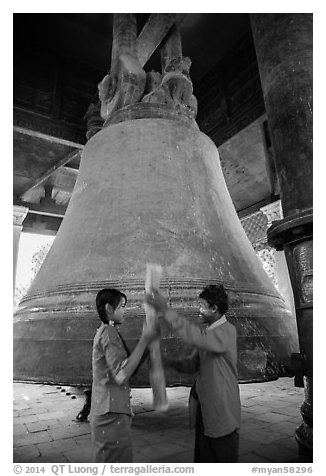 Boy and girl ringing huge bell, Mingun. Myanmar (black and white)