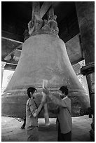 Boy and girl ringing huge bell, Mingun. Myanmar ( black and white)