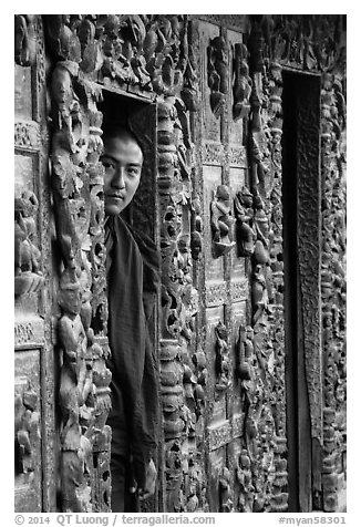 Monk pearing from window, Shwe In Bin Kyaung pagoda. Mandalay, Myanmar (black and white)