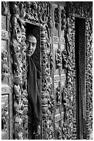 Monk pearing from window, Shwe In Bin Kyaung pagoda. Mandalay, Myanmar ( black and white)