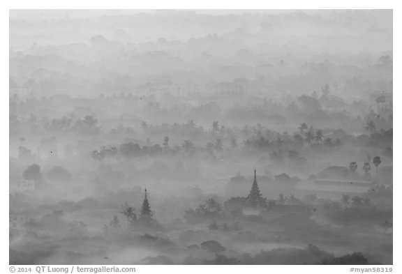 Pagodas and tree ridges in mist as seen from Mandalay Hill. Mandalay, Myanmar (black and white)