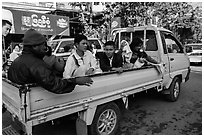 Families riding on back of pick-up truck. Mandalay, Myanmar ( black and white)
