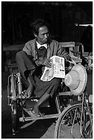 Sai kaa driver sitting on his rickshaw. Mandalay, Myanmar ( black and white)