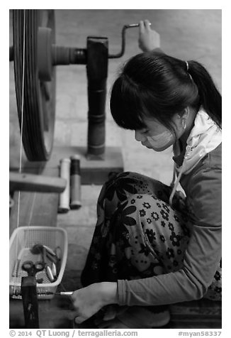 Woman assembling a yarn package. Amarapura, Myanmar (black and white)