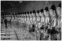 Buddha images in crescent-shaped hall, U Min Thonze pagoda, Sagaing. Myanmar ( black and white)