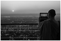 Monk taking picture of sunset from Sagaing Hill. Myanmar ( black and white)