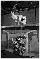 Puppeter handling traditional burmese string marionette. Mandalay, Myanmar ( black and white)