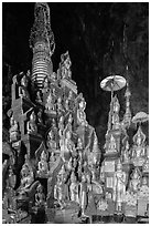 Many buddha images surround main stupa in Pindaya Caves. Pindaya, Myanmar ( black and white)