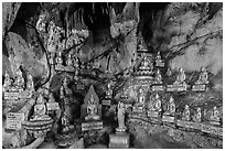 Some of 8,000 buddha images in Pindaya Caves. Pindaya, Myanmar ( black and white)