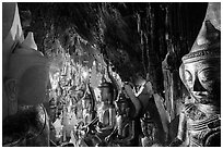 Buddha statues and stalactites in Pindaya Caves. Pindaya, Myanmar ( black and white)