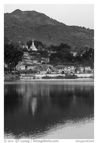 Hill and town reflected in Pone Tanoke Lake at dawn. Pindaya, Myanmar (black and white)