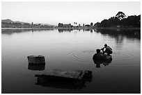 Woman washing laundry in Pone Tanoke Lake at dawn. Pindaya, Myanmar ( black and white)
