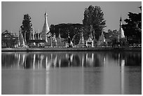 Pagoda reflected in Pone Tanoke Lake at sunrise. Pindaya, Myanmar ( black and white)