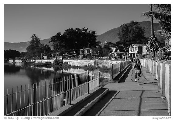 Woman biking near Pone Tanoke Lake. Pindaya, Myanmar (black and white)