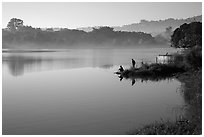 Men on shore of Pone Tanoke Lake. Pindaya, Myanmar ( black and white)