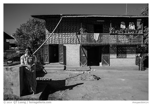 Woman in front of house. Pindaya, Myanmar (black and white)