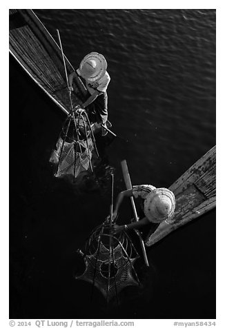 Intha fishermen use spear to stir weed and expose fish. Inle Lake, Myanmar (black and white)