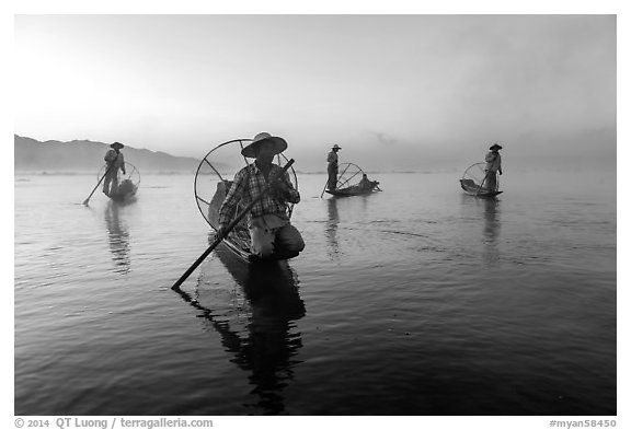 Group of Intha fishermen at dawn with surface mist. Inle Lake, Myanmar (black and white)
