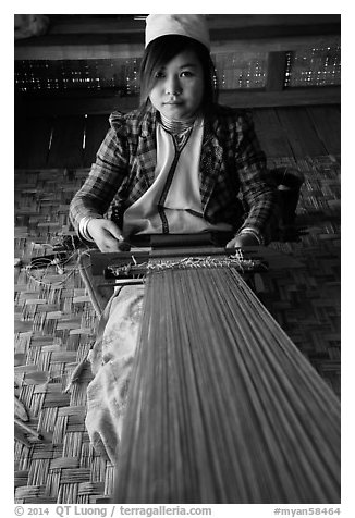 Young padaung woman weaving. Inle Lake, Myanmar (black and white)