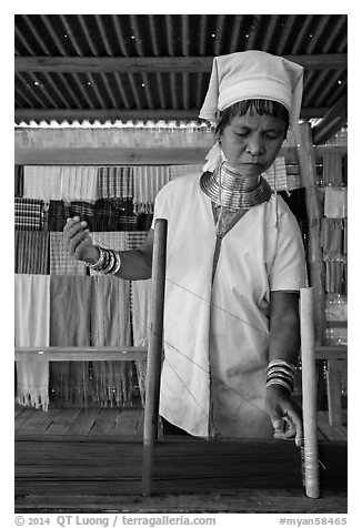 Padaung (long neck) woman threading yarn. Inle Lake, Myanmar (black and white)