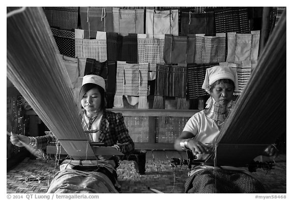 Weaving workshop with Kayan women of the Padaung tribe. Inle Lake, Myanmar (black and white)