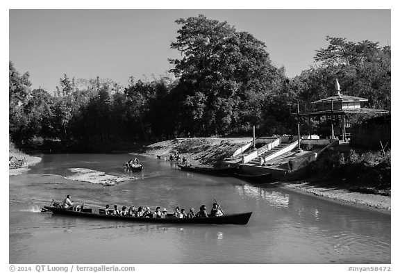 Villagers navigating canal in narrow boat, Indein. Inle Lake, Myanmar (black and white)