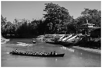 Villagers navigating canal in narrow boat, Indein. Inle Lake, Myanmar ( black and white)