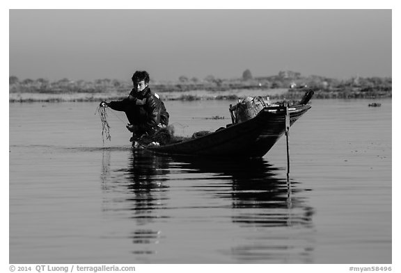 Fisherman retrieves net. Inle Lake, Myanmar (black and white)